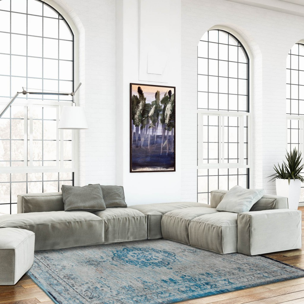 Designer rug brand Louis De Poortere place a modern white and grey living room with a subtle light blue traditional rug negotiated around a grey soft sofa