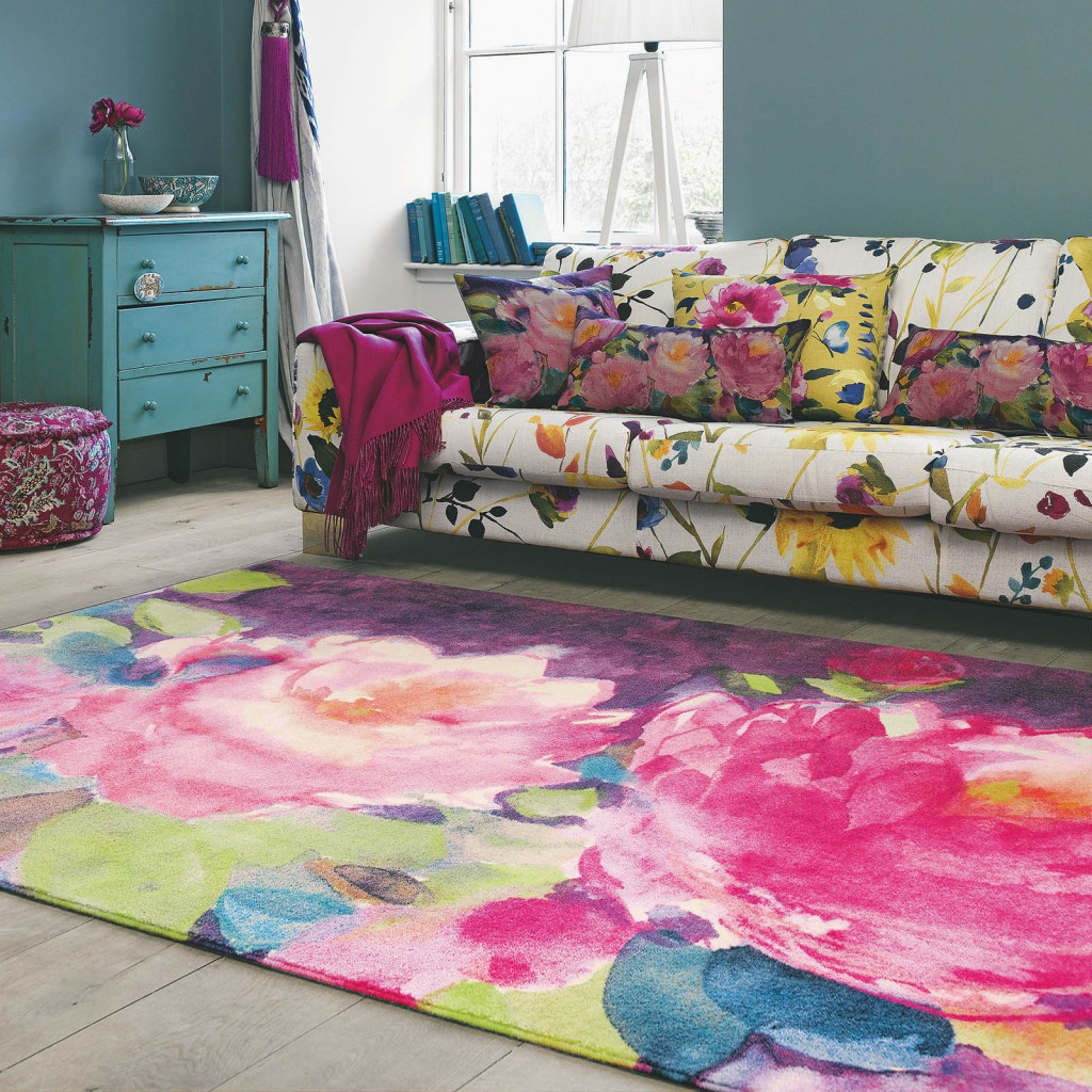 Designer rug brand bluebellgray whith a bright floral rug and sofa in a living room