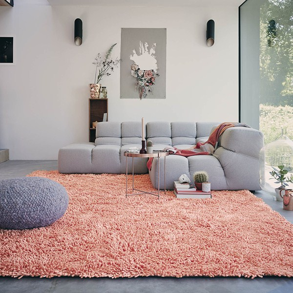 Designer rug brand brink and campman a soft coral pink shaggy rug creates a focal point in a modern living room