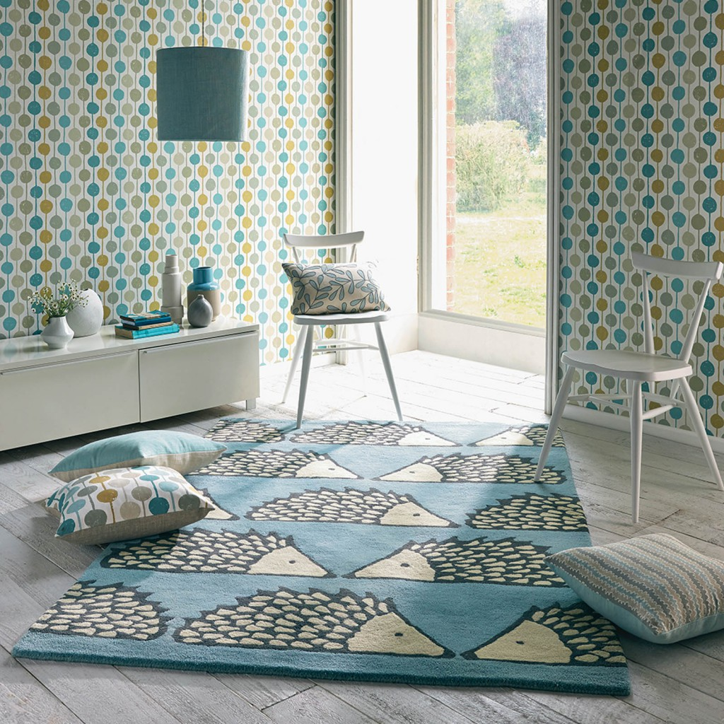 Designer rug brand Scion with a rug with a hedgehog design sits in a modern marine blue styled bedroom
