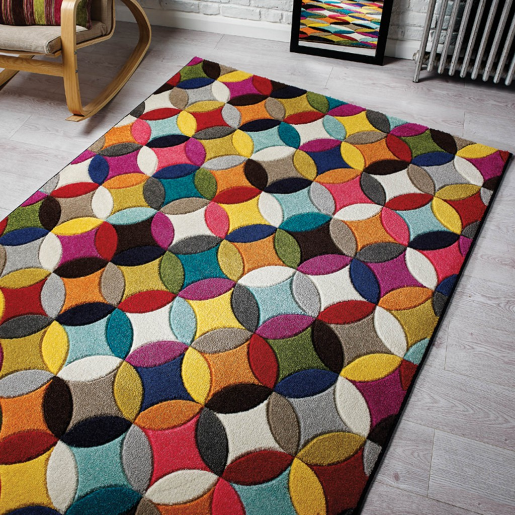 A spectrum geometric and multi coloured rug part of a joint competition