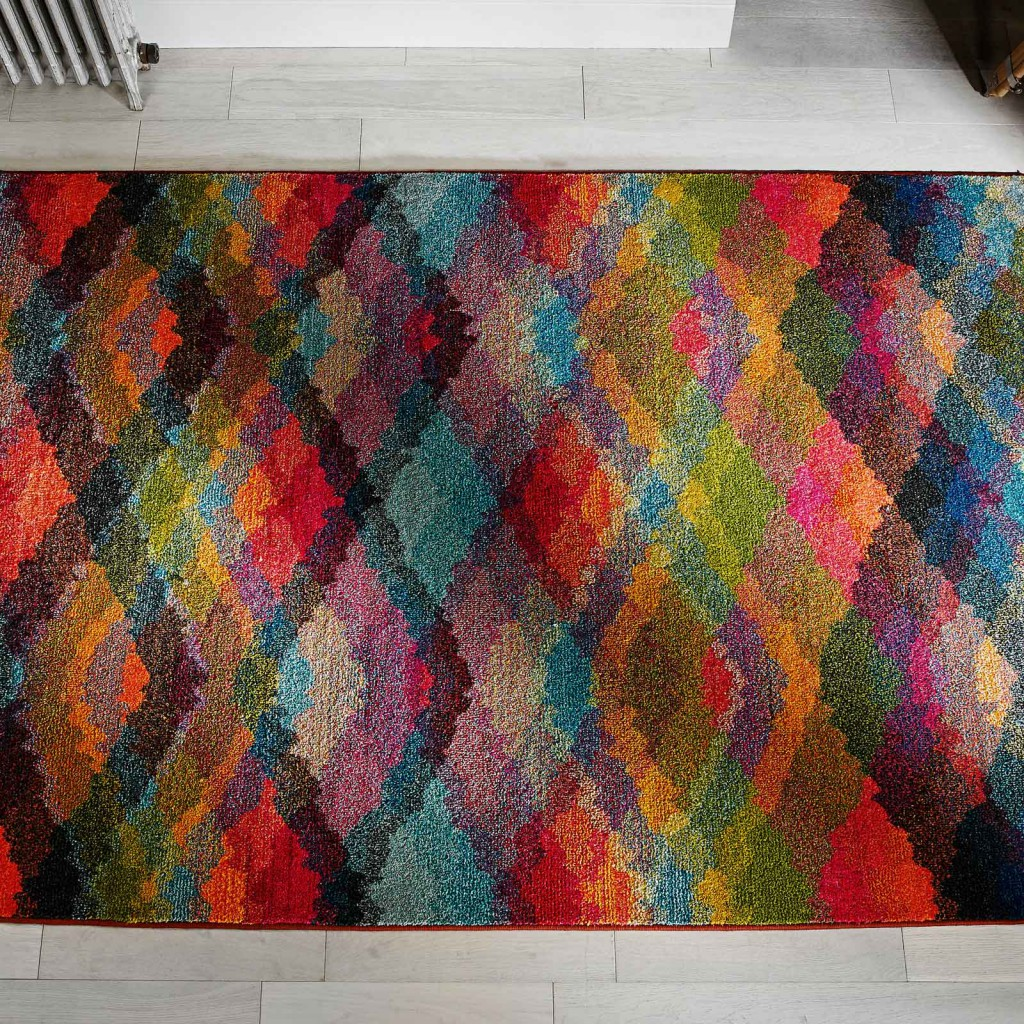 christmas competition Multicoloured Kaleidoscope rug on a grey wooden floor