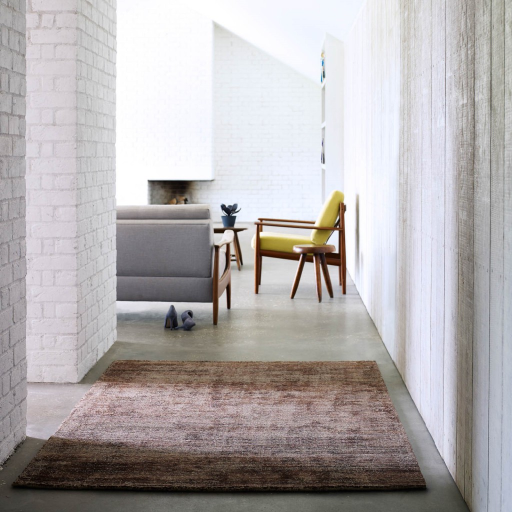 with, urban, modern and minimalist loft with a plain brown rug on a concrete floor