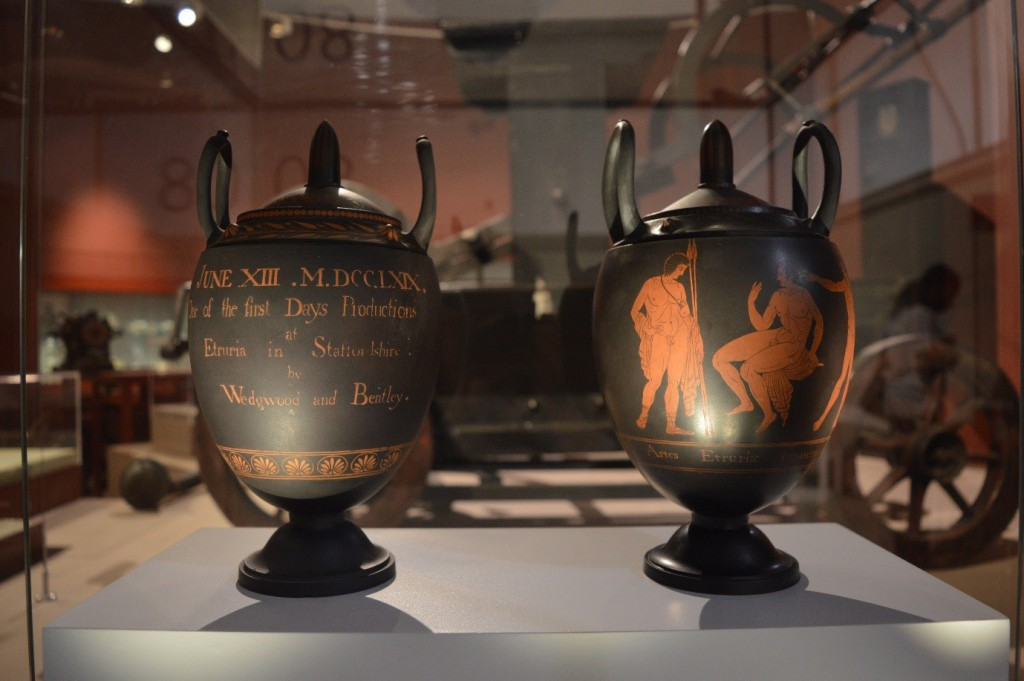 Two Wedgwood The First Day's vases presented in a glass cabinet