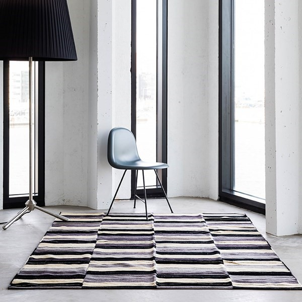 Black and grey coloured Massimo rug in a contemporary living space