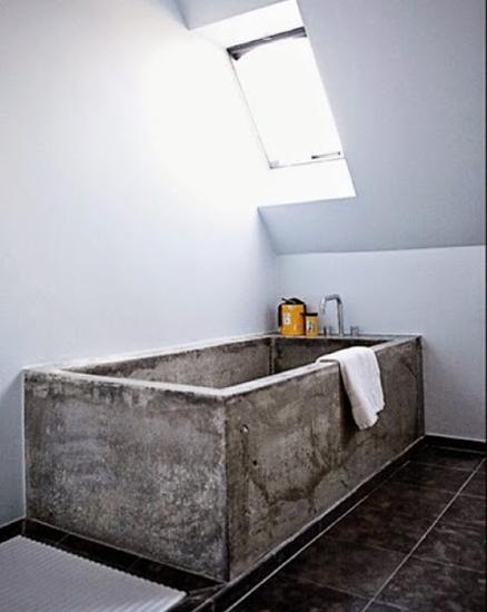 plain bathroom with a concrete bath tub