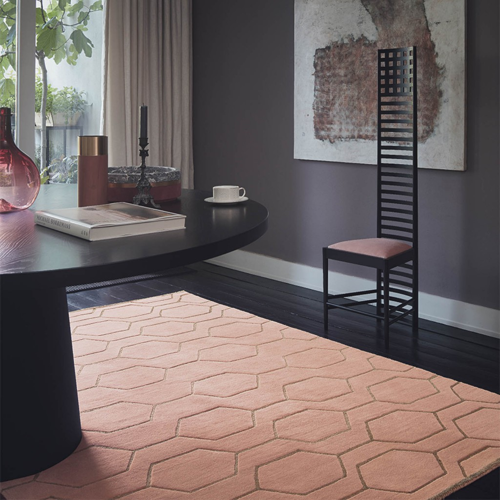 latest rug releases of a colourful and geometric pink wedgwood rug surrounded by other furniture accents