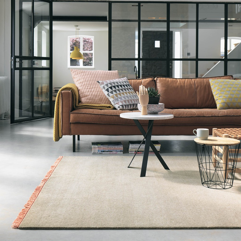 latest rug releases a light pink nima rug by brink and campman in a modern living room