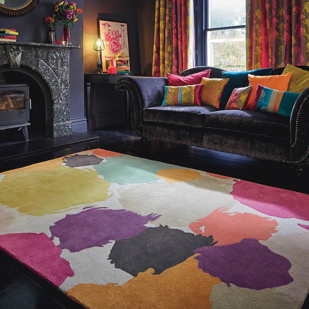 latest rug releases of a painterly design rug with large colourful paint splashes on it in a vintage room