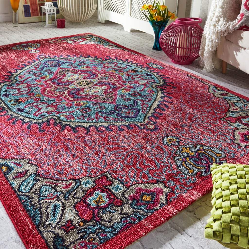 latest rug releases of a colourful and vibrant hot pink rug with a vintage design and bold graphics surrounded by other furniture accents