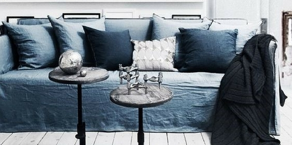 colour trend for 2017 denim blue sofa and cushions on white wooden floor with chrome coffee tables