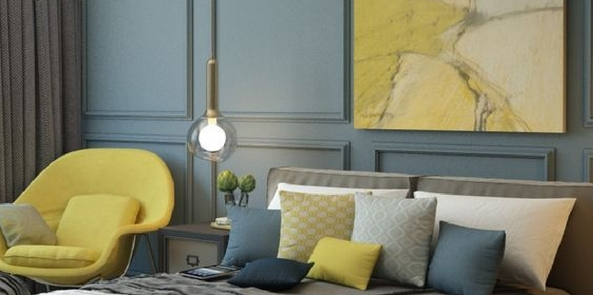 colour trend for 2017 denim blue bedroom with lime yellow chair, cushions and painting and grey bedding