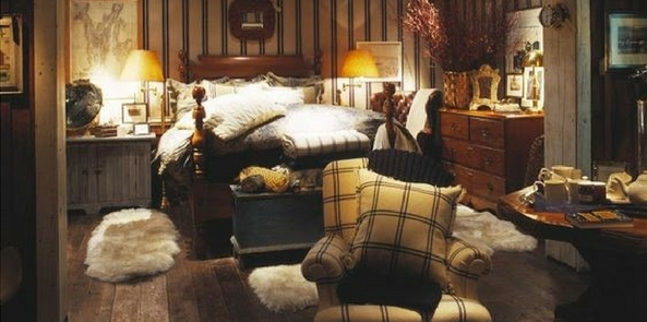 country style faux fur cottage bedroom with a lot of cream fur rugs and throws and tweed armchair and walls