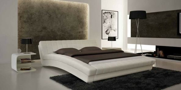 minimalist style faux fur rug and walls in a white themed bedroom with leather bed on a pale grey floor