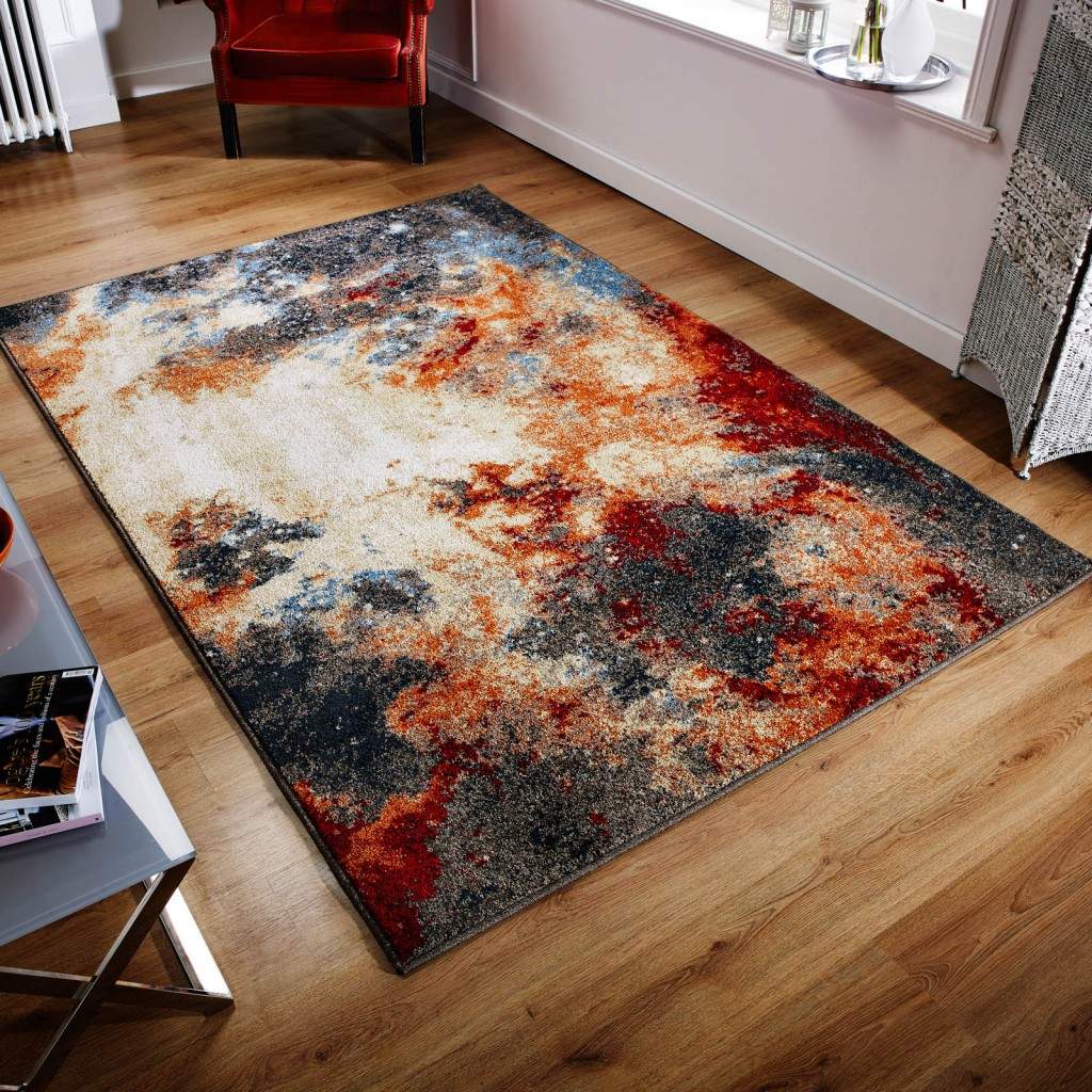 latest rug releases of a cosmic space zante rug on a hardwood floor surrounded by other furniture accents