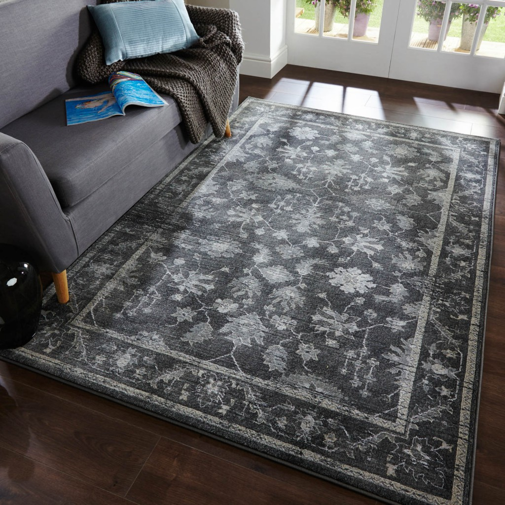 latest rug releases of a black and grey traditional rug with a faded vintage look and a flower motif