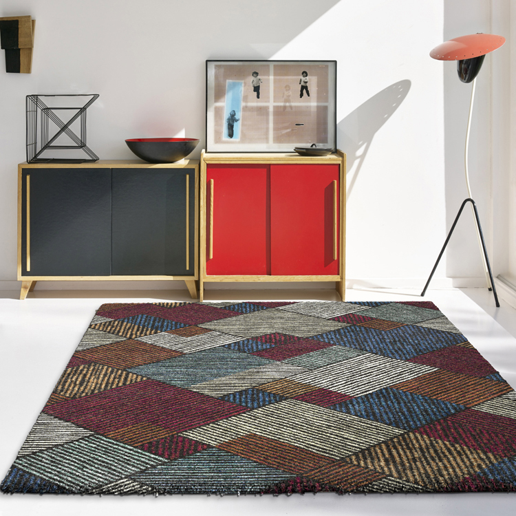 hipster interior design living room with red cabinets and chairs with a multicoloured rug beneath