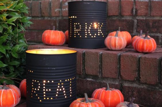 DIY halloween decorationsblack can lumineres on front porch steps reading trick and treat next to pumpkins