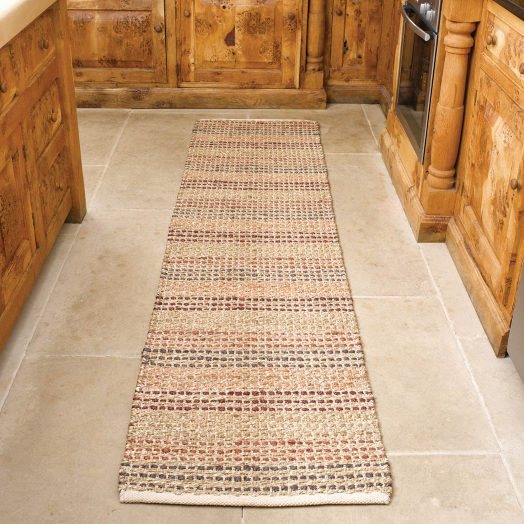 the best hallway runners seagrass runner in terracotta in a wooden kitchen on tiled floors