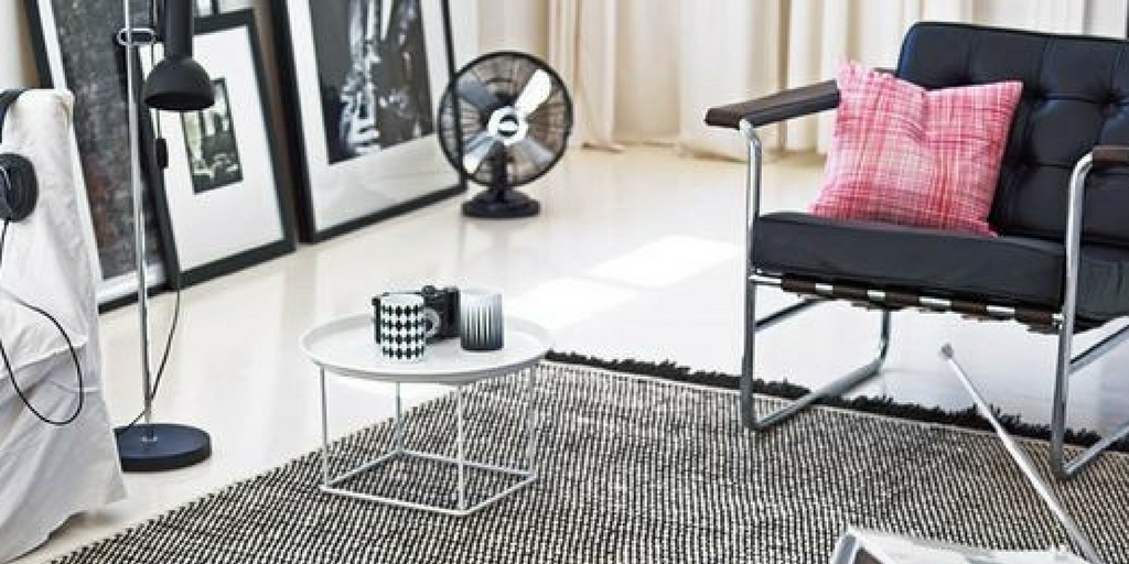 hipster interior design grey rug on white flooring with vintage home accessories surrounding