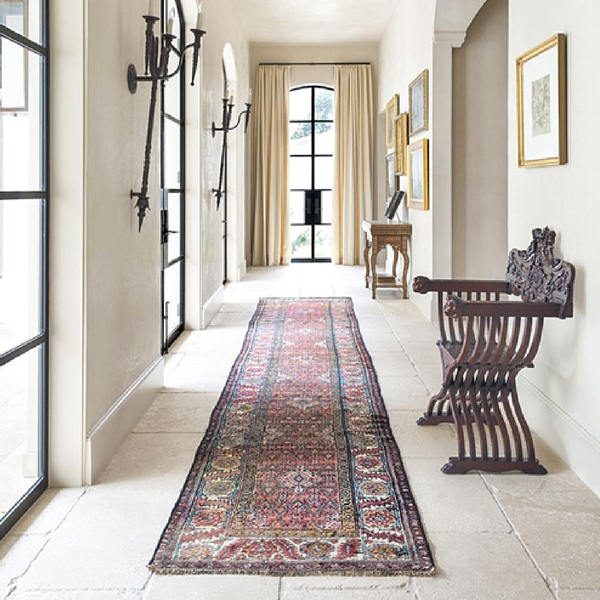 a traditional style best hallway runners rug in a rustic space with paved floors and plastered walls and dark brown wooden features