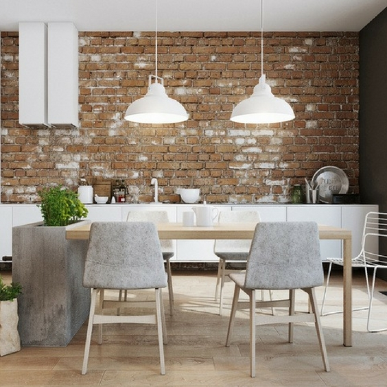hipster home decor with concrete chairs around a wooden table with exposed brick walls and a metal light fixture