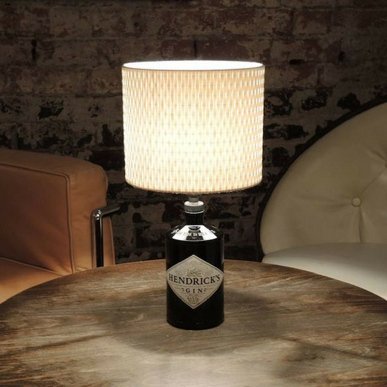 hipster home decor of upcycled hendricks bottle as a lamp on a wooden table