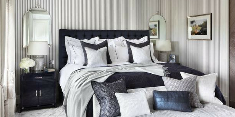 stripes trend black and white coloured bedroom with pinstripe wallpaper and a double bed