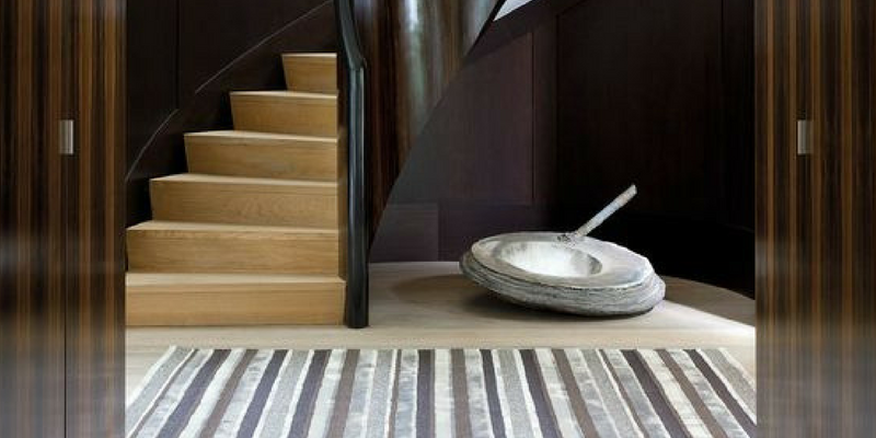 stripes trend shades of grey coloured rug in a large interior