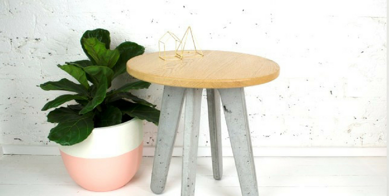 concrete furniture a concrete stool with a wooden base and a plant pot beside it