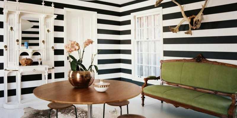 stripes trend black and white monochrome living room with green sofa