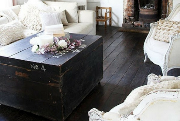small space with an ottoman chest in dark brown wood in a living room with dark brown wooden floor and white sofas
