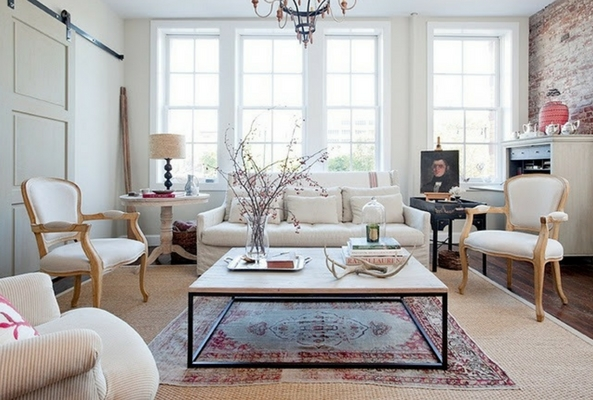 layering rugs in traditional style over jute base in a neutrally coloured living room