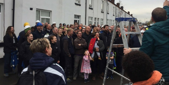 DIY SOS team and builders at canada street home for simon flores posing for a group photo