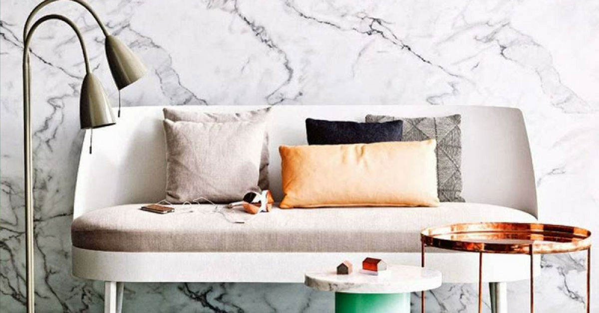 interior design trends marble living room with a copper table