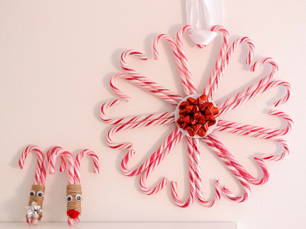 Christmas hanging candy canes with a garland