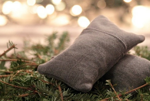 small material bag on a pine tree to make room smell like christmas