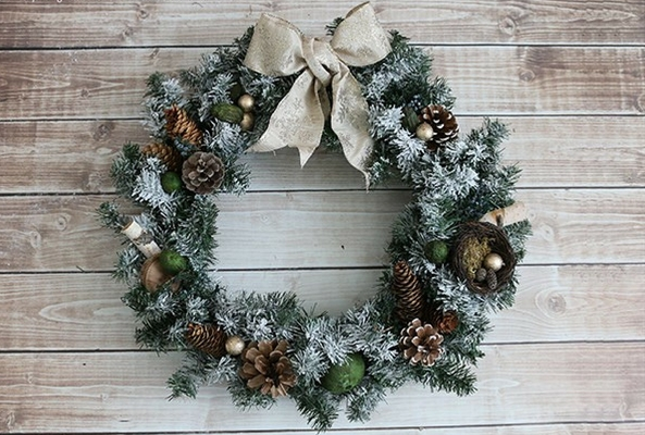 a classic fir wreath with pinecones tied with a gold ribbon and potpurri for a smell like christmas