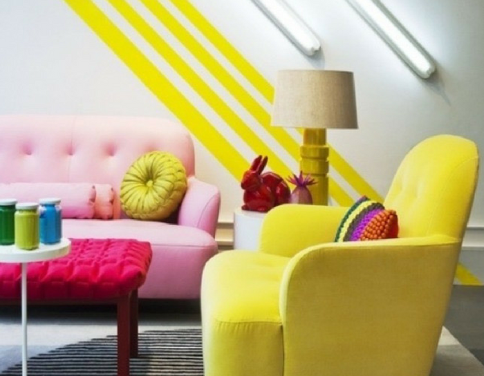 playful interiors bright and bold yellow and hot pink couches in a large room