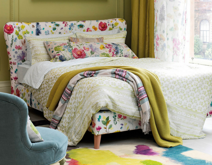 playuful interiors floral bedroom with a colourful rug
