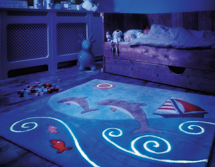 playful interiors glow in the dark blue rug