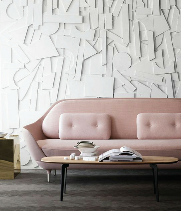 blush pink living room with a modern wall