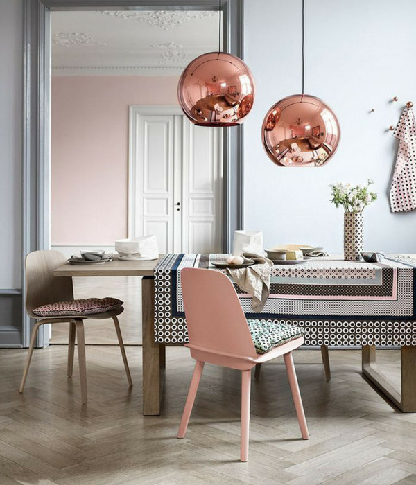 blush pink dining room with copper lighting accents