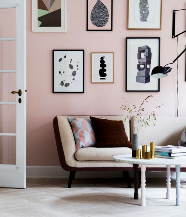 blush pink living room with creative wall art