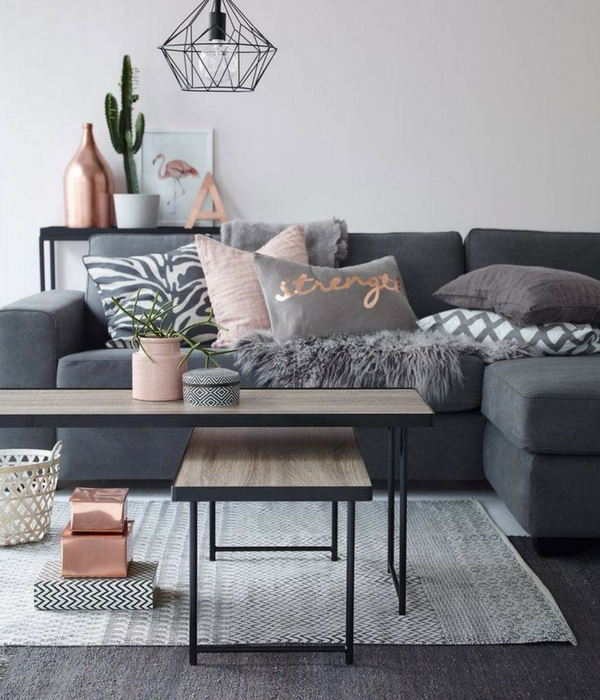 blush pink accents pillows on a grey sofa