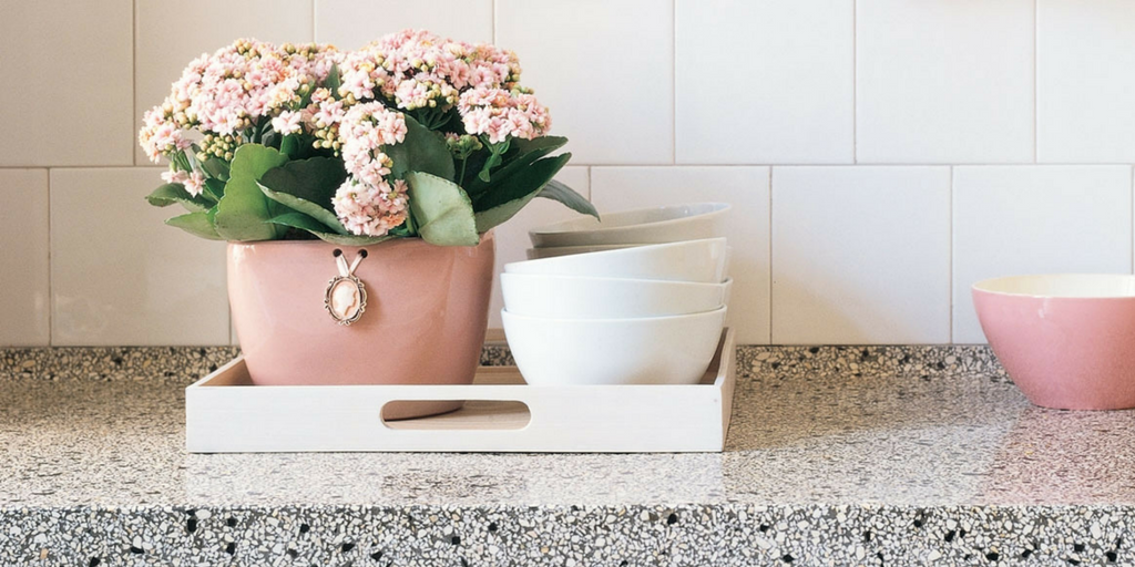 blush pink flowers on a kitchen counter