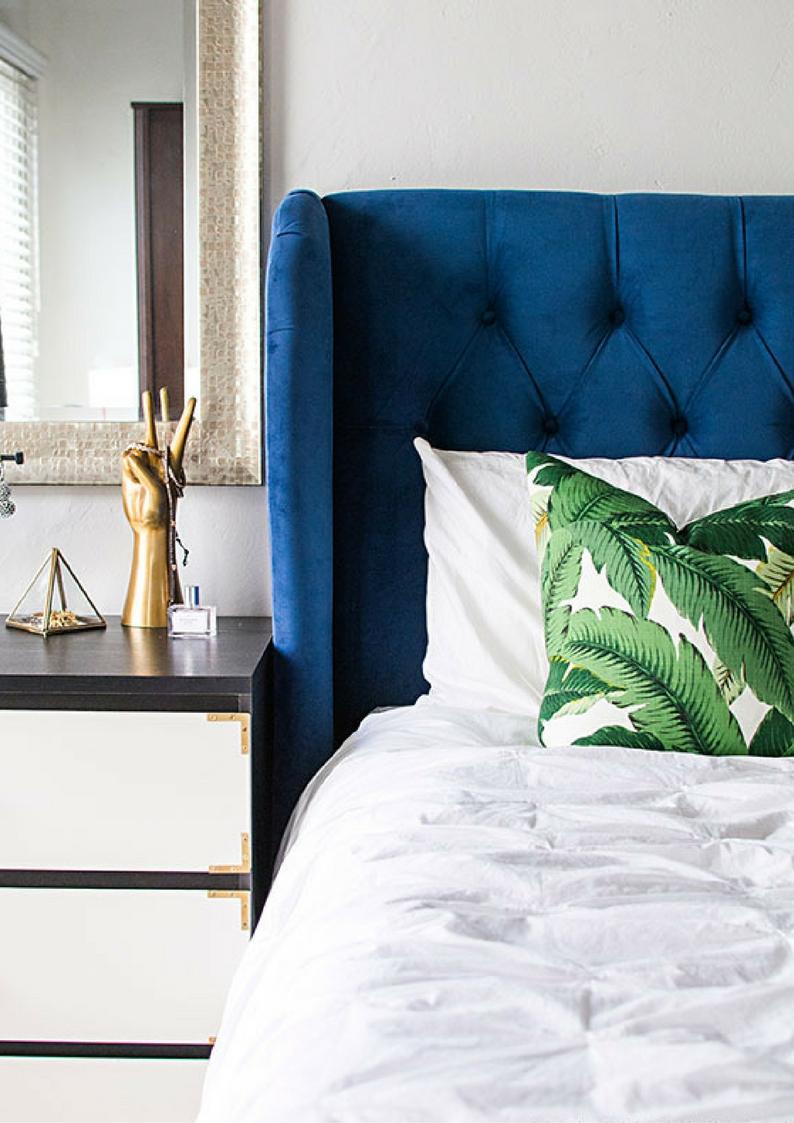 botanical leaf motif patterned pillows on a bed