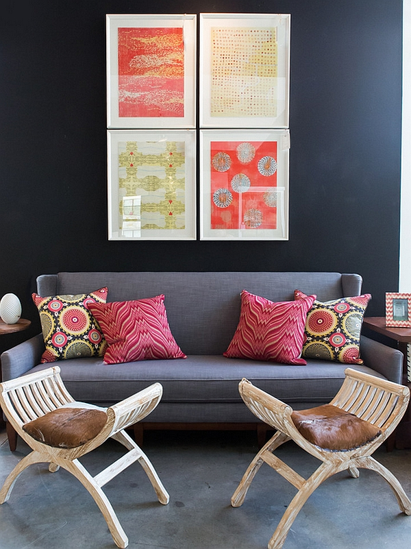 a colourful bohemian living room with bold wall art