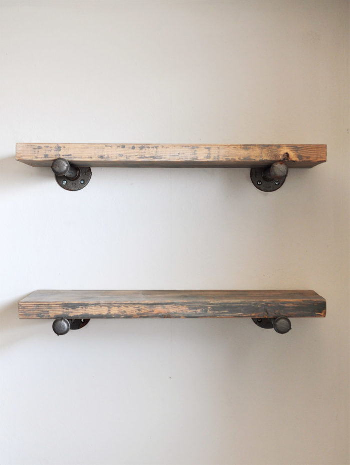 industrial style homemade shelves made from metal pipe and wood