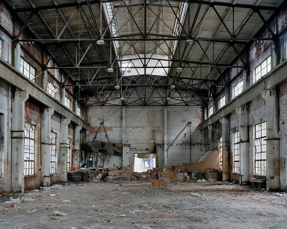 Old abandoned warehouse with exposed brick and metal beams on the ceiling